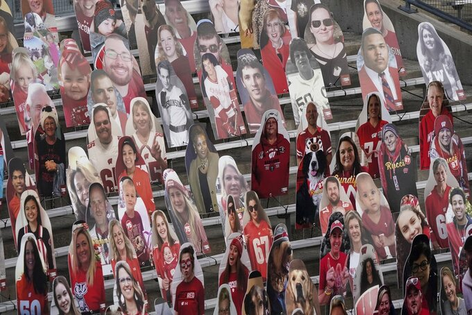 Cardboard cutouts are seen in the seats before an NCAA college football game between Wisconsin and Indiana Saturday, Dec. 5, 2020, in Madison, Wis. (AP Photo/Morry Gash)