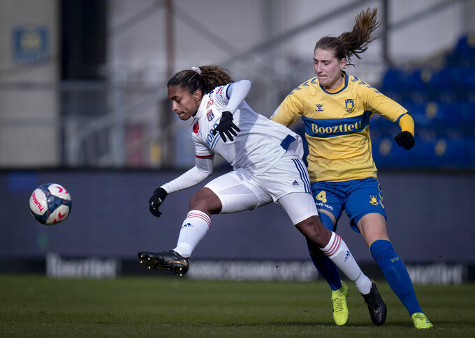 Olympique Lyon's Catarina Cantanhede Macario, left, and Broendby's Maja Kildemoes in action during their Womens Champions League last 16 soccer match at Broendby Stadion, Denmark, Wednesday March 10, 2021. (Liselotte Sabroe/Ritzau via AP)