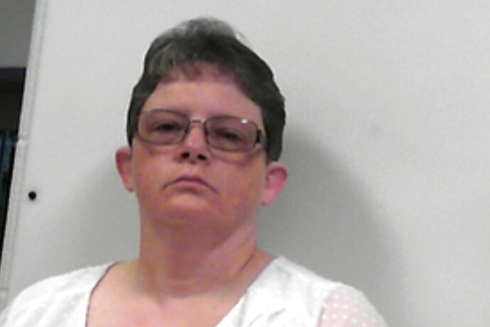 This photo released Tuesday, July 14, 2020, by the West Virginia Regional Jail and Correctional Facility Authority shows Reta Mays, a former nursing assistant at the Louis A. Johnson VA Medical Center in Clarksburg, W.Va. Mays, pleaded guilty Tuesday to intentionally killing seven patients with fatal doses of insulin. She was charged with seven counts of second-degree murder and one count of assault with the intent to commit murder of an eighth person. She faces life sentences for each murder. (West Virginia Regional Jail and Correctional Facility Authority via AP)