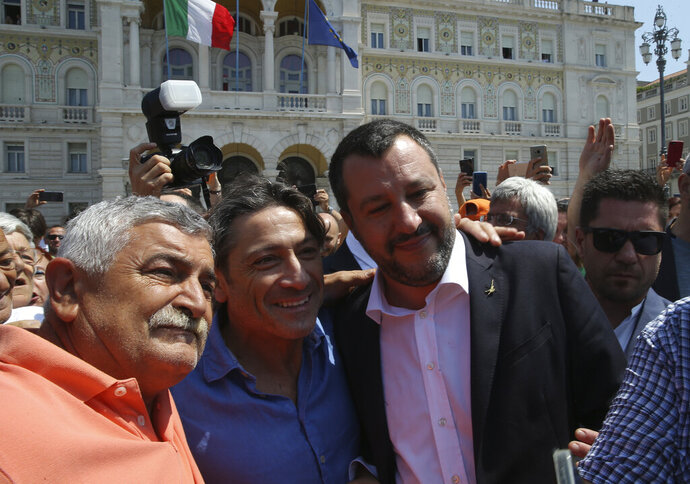 Italy's deputy prime minister Matteo Salvini, right, is greeted by supporters in Trieste, Italy, Friday, July 5, 2019. Salvini said Friday that Italy is ready to use more resources to
