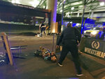 FILE - In this image provided by Gabriele Sciotto taken on Saturday, June 3, 2017, one of the suspects from the London Bridge attack, wearing what appear to be canisters strapped to his chest, lies on the ground after being shot by police outside Borough Market in London. In the 20 years since the Sept. 11, 2001 terrorist attacks in the United States, a mixture of homegrown extremists, geography and weaknesses in counterterrorism strategies have combined to turn Europe into a prime target for jihadists bent on hurting the West. (Gabriele Sciotto via AP, File)