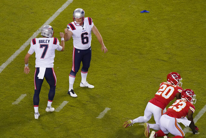 New England Patriots place kicker Nick Folk (6) celebrates with teammate Jake Bailey (7) after kicking a 43-yard field goal during the first half of an NFL football game against the Kansas City Chiefs, Monday, Oct. 5, 2020, in Kansas City. (AP Photo/Charlie Riedel)