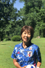 This handout provided by Kikuko Okajima, shows Kikuko Okajima at her home in Baltimore, Md. The woman leading Japan's ambitious effort to launch a professional women's soccer league lives in Baltimore. Yes, Maryland, some 6,700 miles away. (Andy Murray via AP)