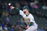 Oakland Athletics relief pitcher James Kaprielian throws against the Seattle Mariners in the fifth inning of a baseball game Monday, Sept. 27, 2021, in Seattle. (AP Photo/Elaine Thompson)