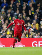 Liverpool's Sadio Mane celebrates after scoring his side's opening goal during the English Premier League soccer match between Norwich City and Liverpool at Carrow Road Stadium in Norwich, England, Saturday, Feb. 15, 2020. (AP Photo/Frank Augstein)