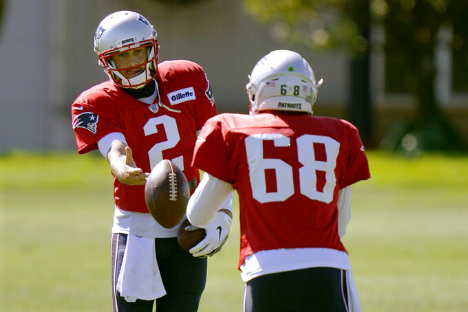 New England Patriots quarterbacks Brian Hoyer, left, and Brian Lewerke toss the ball during an NFL football practice, Monday, Aug. 31, 2020, in Foxborough, Mass. (AP Photo/Steven Senne)