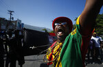 Pastor Past, of the performance group Kominote Zan77, screams during a march led by the art community that continues demanding the resignation of Haitian President Jovenel Moise in Port-au-Prince, Haiti, Sunday, Oct. 13, 2019. Protests have paralyzed the country for nearly a month, shuttering businesses and schools. (AP Photo/Rebecca Blackwell)