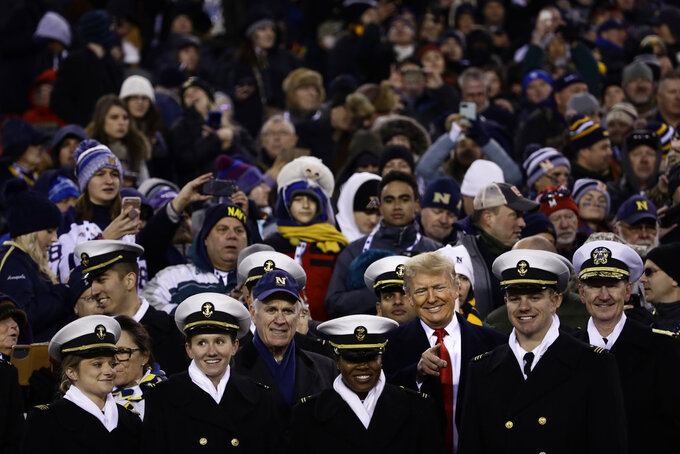 President Donald Trump stands in the seating along the Navy sidelines before the second half of a NCAA college football game between Army and Navy, Saturday, Dec. 8, 2018, in Philadelphia. (AP Photo/Matt Rourke)