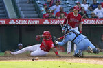 Los Angeles Angels' Justin Upton, left, scores past Toronto Blue Jays catcher Reese McGuire on a fielding error by Blue Jays first baseman Vladimir Guerrero Jr. following a fly ball hit by Jo Adell during the fifth inning in the first baseball game of a doubleheader Tuesday, Aug. 10, 2021, in Anaheim, Calif. (AP Photo/Marcio Jose Sanchez)