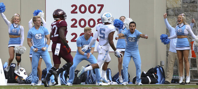 North Carolina's Dazz Newsome (5) scores on a 58-yard touchdown play past Virginia Tech defender Chamarri Conner (22) in the first quarter of an NCAA college football game Saturday, Oct. 19 2019, in Blacksburg Va. (Matt Gentry/The Roanoke Times via AP)