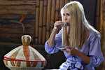 White House senior adviser Ivanka Trump sips coffee during a coffee ceremony at Dumerso Coffee, Sunday April 14, 2019, in Addis Ababa, Ethiopia. Trump is visiting Ethiopia and then Ivory Coast to promote a global economical program for women. (AP Photo/Jacquelyn Martin)