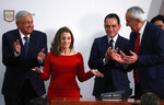 Deputy Prime Minister of Canada Chrystia Freeland, second left, acknowledges the applause as Mexico's top trade negotiator Jesus Seade, right, Mexico's Treasury Secretary Arturo Herrera, second right, and Mexico's President Andres Manuel Lopez Obrador, left, applaud after signing an update to the North American Free Trade Agreement, at the national palace in Mexico City, Tuesday, Dec. 10. 2019.(AP Photo/Marco Ugarte)