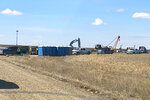 This photo from early May, 2020, provided by Angeline Cheek shows a construction site for the XL Pipeline just inside the U.S.-Canadian border near Saco, Mont. Members of several tribes in Montana and North Dakota traveled to the border crossing for a small protest against the pipeline earlier this month, according to Cheek, an activist from Montana's Fort Peck Tribe and organizer for the ACLU of Montana. Calgary-based TC Energy has built the first piece of the disputed Keystone XL oil sands pipeline across the U.S. border and started work on labor camps in Montana and South Dakota. (Angeline Cheek via AP)