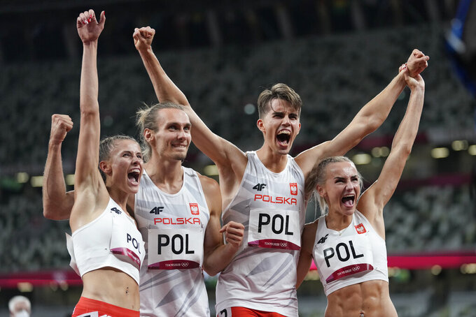 The team from Poland celebrates after winning the 4 x 400-meter mixed relay final at the 2020 Summer Olympics, Saturday, July 31, 2021, in Tokyo. (AP Photo/Petr David Josek)