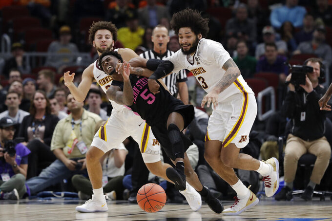 Penn State's Jamari Wheeler (5) and Minnesota's Jordan Murphy (3) battle for a loose ball during the second half of an NCAA college basketball game in the second round of the Big Ten Conference tournament, Thursday, March 14, 2019, in Chicago. (AP Photo/Nam Y. Huh)