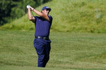 FILE - In this Aug. 20, 2020, file photo, PhilMickelson hits from the rough on the 14th fairway in the first round of the Northern Trust golf tournament at TPC Boston in Norton, Mass. Mickelson will begin his preparation for the Masters in earnest on Friday, Oct. 16, 2020, at a place, and on a tour, not typically associated with the regimen required to win a major. The lefthander is making his second start on the PGA Tour Champions in the Dominion Energy Charity Classic at the Country Club of Virginia's somewhat forgiving James River course. (AP Photo/Charles Krupa, File)
