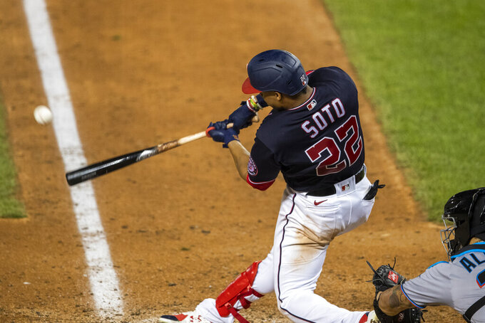 Washington Nationals' Juan Soto (22) hits a one-run double during the seventh inning of a baseball game against the Miami Marlins in Washington, Monday, Aug. 24, 2020. (AP Photo/Manuel Balce Ceneta)