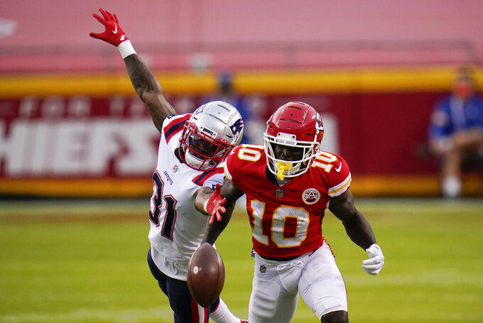 New England Patriots cornerback Jonathan Jones (31) breaks up a pass intended for Kansas City Chiefs wide receiver Tyreek Hill (10) during the first half of an NFL football game, Monday, Oct. 5, 2020, in Kansas City. (AP Photo/Jeff Roberson)