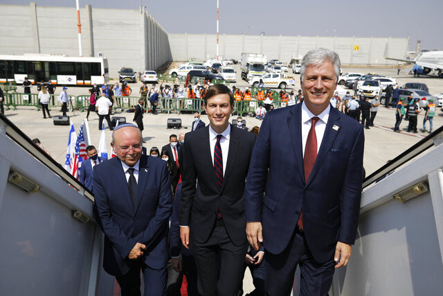 Israeli National Security Advisor Meir Ben-Shabbat, left, U.S. President Donald Trump's senior adviser Jared Kushner, center, and U.S. National Security Advisor Robert O'Brien, right, board the Israeli flag carrier El Al's airliner as they fly to Abu Dhabi for talks meant to put final touches on the normalization deal between the United Arab Emirates and Israel, at Ben-Gurion International Airport, near Tel Aviv, Israel Monday, Aug. 31, 2020. (Nir Elias/Pool Photo via AP)