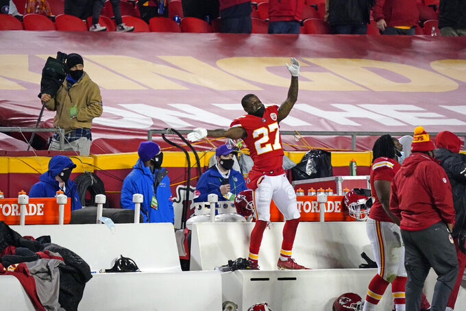 Kansas City Chiefs cornerback Rashad Fenton celebrates on the bench during the second half of the AFC championship NFL football game against the Buffalo Bills, Sunday, Jan. 24, 2021, in Kansas City, Mo. (AP Photo/Jeff Roberson)