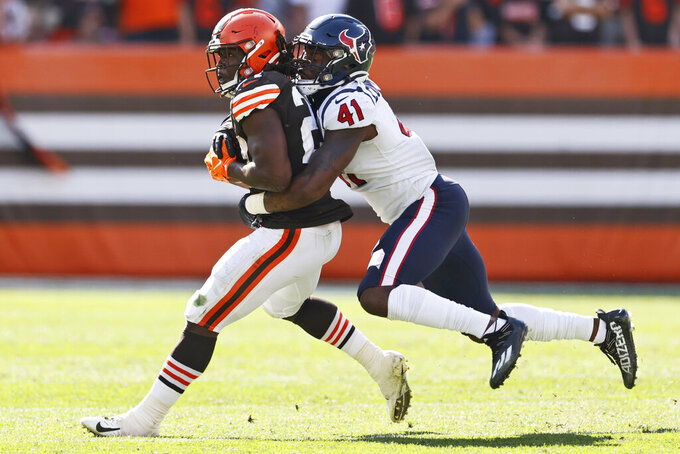 Houston Texans inside linebacker Zach Cunningham (41) tackles Cleveland Browns running back Kareem Hunt (27) after a pass reception during the second half of an NFL football game, Sunday, Sept. 19, 2021, in Cleveland. The Browns won 31-21. (AP Photo/Ron Schwane)
