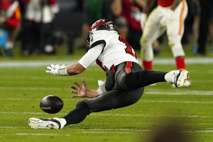 Tampa Bay Buccaneers quarterback Tom Brady recovers a fumble on a high snap during the second half of the NFL Super Bowl 55 football game against the Kansas City Chiefs, Sunday, Feb. 7, 2021, in Tampa, Fla. (AP Photo/Gregory Bull)