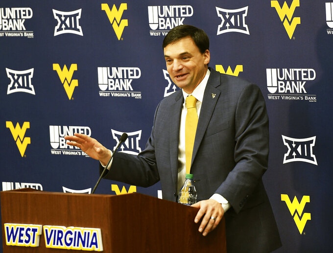 FILE - In this Jan. 10, 2019, file photo, West Virginia University's new NCAA college football head coach Neal Brown gestures while speaking during an introductory press conference in Morgantown, W.Va. The 2019 Most Likely to Succeed list ranks the new hires in FBS. (Ron Rittenhouse/The Dominion-Post via AP, File)