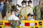 One of the evacuees from Afghanistan undergoes a COVID test after disembarking from a U.S. airforce plane at the Naval Station in Rota, southern Spain, Tuesday Aug. 31, 2021. The United States completed its withdrawal from Afghanistan late Monday, ending America's longest war.(AP Photo/ Marcos Moreno)