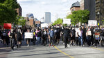 Protesters demonstrate Sunday, May 31, 2020, in Boston, over the death of George Floyd, a black man who was in police custody in Minneapolis. Floyd died after being restrained by Minneapolis police officers on Memorial Day. (AP Photo/Steven Senne)