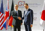 Japan's Deputy Commissisioner General Mitsuhiro Matsumoto, left, is welcomed by French Interior Minister Christophe Castaner for a G7 meeting at ministerial level in Paris, Thursday April 4, 2019. Foreign and interior ministers from the Group of Seven are gathering in France this week to try to find ambitious solutions to world security challenges. Putting a dampener on that are two glaring American absences: U.S. Secretary of State Mike Pompeo and Homeland Security Secretary Kirstjen Nielsen. (AP Photo/Michel Euler)