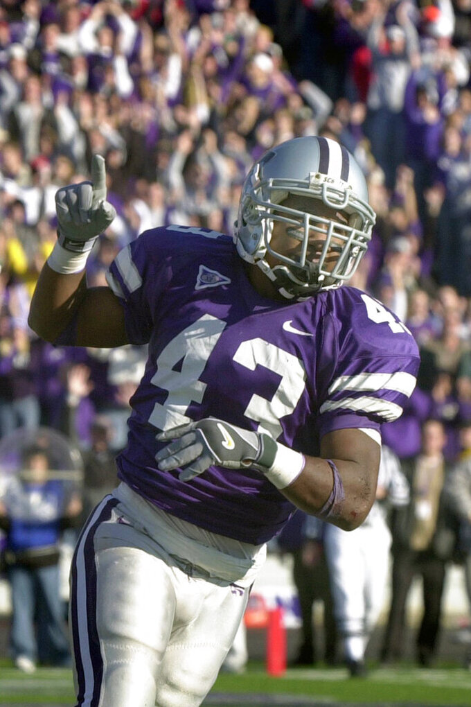 FILE - In this Nov. 16, 2002, file photo, Kansas State running back Darren Sproles celebrates after scoring a touchdown in the fourth quarter of an NCAA college football game, in Manhattan, Kan. Georgia cornerback Champ Bailey, Syracuse defensive end Dwight Freeney and Kansas State running back Darren Sproles will appear on the College Hall of Fame ballot for the first time. The National Football Foundation announced Tuesday, June 16, 2020, the 78 players and seven coaches from major college who are up for selection to the Hall of Fame. (AP Photo/Charlie Riedel, File)