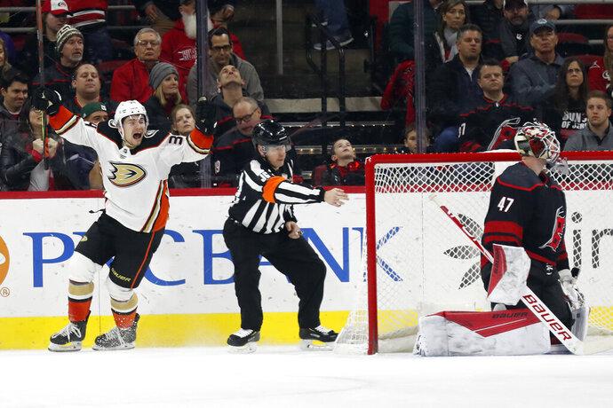 Anaheim Ducks center Sam Steel (34) celebrates his overtime goal against Carolina Hurricanes goaltender James Reimer (47) in an NHL hockey game in Raleigh, N.C., Friday, Jan. 17, 2020. Anaheim won 2-1. (AP Photo/Gerry Broome)