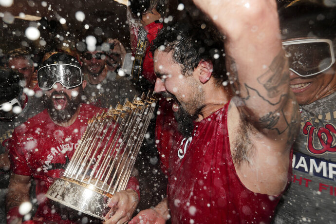 Washington Nationals third baseman Anthony Rendon and Adam Eaton celebrate in the locker room after Game 7 of the baseball World Series against the Houston Astros Wednesday, Oct. 30, 2019, in Houston. The Nationals won 6-2 to win the series. (AP Photo/David J. Phillip)