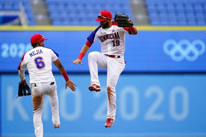 Dominican Republic's Jose Bautista, right, and Erick Mejia celebrate after Dominican Republic won a baseball game against Mexico at Yokohama Baseball Stadium during the 2020 Summer Olympics, Friday, July 30, 2021, in Yokohama, Japan. (AP Photo/Matt Slocum)