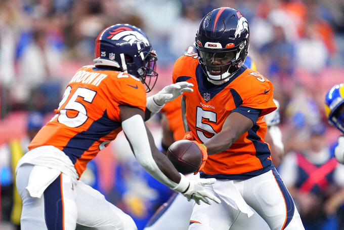 FILE - In this Saturday, Aug. 28, 2021, file photo, Denver Broncos quarterback Teddy Bridgewater (5) hands off to running back Melvin Gordon (25) during the first half of an NFL preseason football game against the Los Angeles Rams in Denver. The Broncos take on the New York Giants on Sunday.  (AP Photo/Jack Dempsey, File)