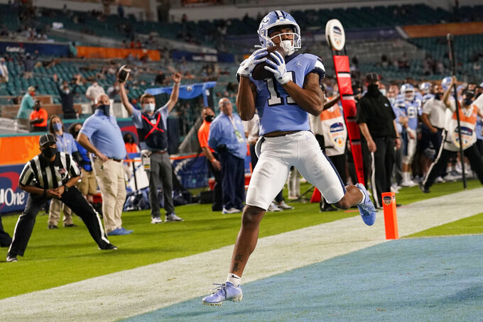North Carolina wide receiver Josh Downs (11) grabs a pass for a touchdown during the second half of the Orange Bowl NCAA college football game against Texas A&M, Saturday, Jan. 2, 2021, in Miami Gardens, Fla. (AP Photo/Lynne Sladky)