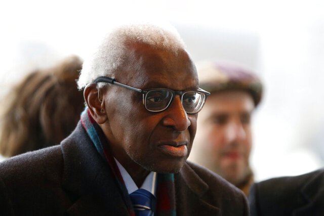CAPTION CORRECTS SPELLING OF SURNAME Former president of the IAAF (International Association of Athletics Federations) Lamine Diack arrives at the Paris courthouse, Monday, Jan. 13, 2020. One of the biggest sports corruption cases to reach court is being heard in Paris from Monday, with explosive allegations of a massive doping cover-up at the top of track and field. (AP Photo/Thibault Camus)