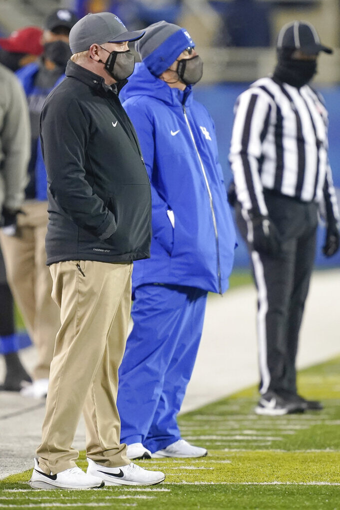 Kentucky head coach Mark Stoops, left, stands with offensive coordinator Eddie Grand during the second half of an NCAA college football game against South Carolina, Saturday, Dec. 5, 2020, in Lexington, Ky. (AP Photo/Bryan Woolston)
