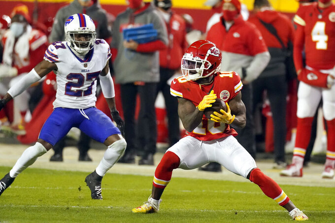 Kansas City Chiefs wide receiver Tyreek Hill catches a pass in front of Buffalo Bills cornerback Tre'Davious White (27) during the second half of the AFC championship NFL football game, Sunday, Jan. 24, 2021, in Kansas City, Mo. (AP Photo/Charlie Riedel)