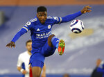 Leicester's Kelechi Iheanacho controls the ball during the English Premier League soccer match between Leicester City and Crystal Palace at the King Power Stadium in Leicester, England, Monday, April 26, 2021. (Adrian Dennis/Pool via AP)