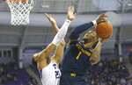 West Virginia forward Derek Culver (1) goes up for a shot as TCU forward Jaedon LeDee (23) defends during the first half of an NCAA college basketball game, Saturday, Feb. 22, 2020 in Fort Worth, Texas. (AP Photo/Ron Jenkins)