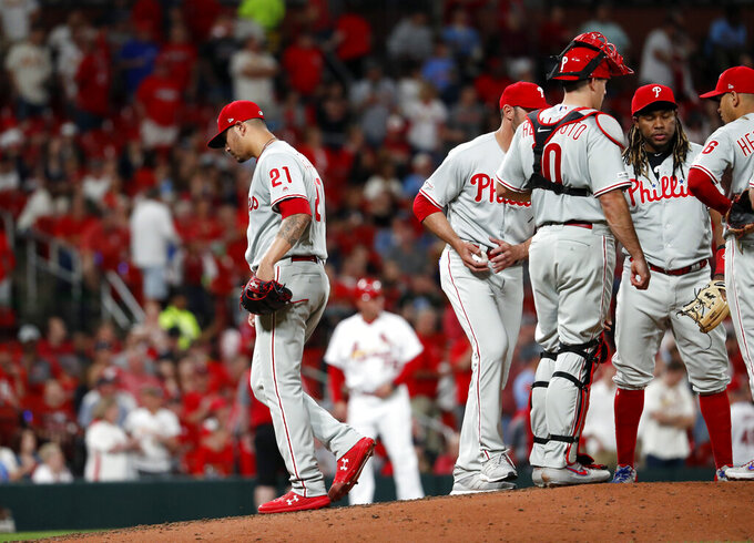 Philadelphia Phillies starting pitcher Vince Velasquez (21) walks off the field after being removed during the fifth inning of a baseball game against the St. Louis Cardinals, Monday, May 6, 2019, in St. Louis. (AP Photo/Jeff Roberson)