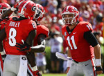 Georgia wide receiver Riley Ridley (8) is congratulated as he scored a touchdown against Austin Peay during the first half of an NCAA college football game, Saturday, Sept. 1, 2018, in Athens, Ga. (AP Photo/Mike Stewart)