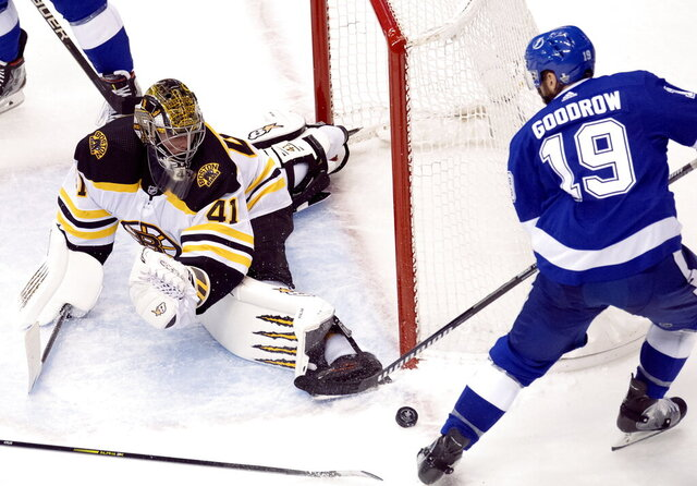 Boston Bruins goaltender Jaroslav Halak (41) makes a save on Tampa Bay Lightning center Barclay Goodrow (19) during the second period of an NHL Stanley Cup Eastern Conference playoff hockey game in Toronto, Ontario, Sunday, Aug. 23, 2020. (Frank Gunn/The Canadian Press via AP)
