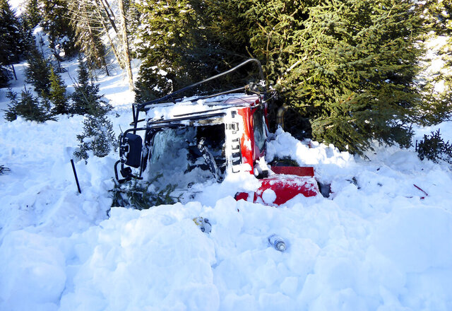 This Feb. 28, 2020 photo shows snow filling the cab of a Montana State Parks PistenBully 100 snow groomer, hours after it was swept about 165 feet downhill when it was struck by an avalanche. The driver, Daniel Kristensen of Belgrade, Mont., was not injured. He had been grooming snowmobile trails for the Gallatin Valley Snowmobile Association on Feb. 27 when the slide pushed him off an old logging road. (Doug Chabot/Gallatin National Forest Avalanche Center via AP)