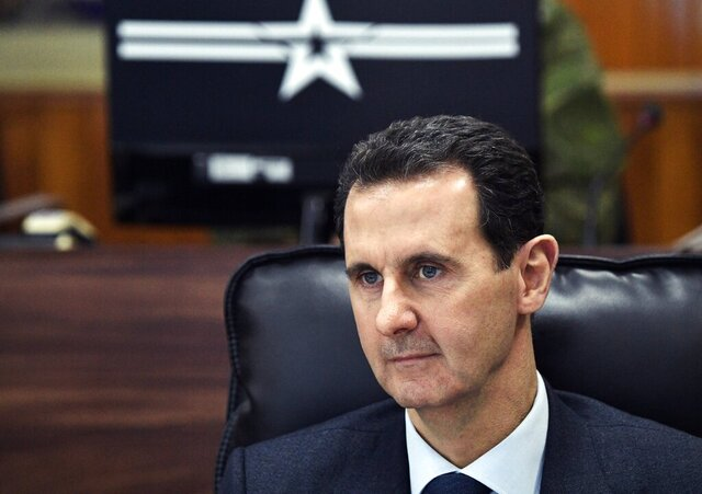 FILE - In this Jan. 7, 2020, file photo, Syrian President Bashar Assad listens to Russian President Vladimir Putin during their meeting in Damascus, Syria. The Trump administration is ramping up pressure on Syrian President Bashar Assad and his inner circle with a raft of new economic and travel sanctions for human rights abuses. (Alexei Nikolsky, Sputnik, Kremlin Pool Photo via AP)