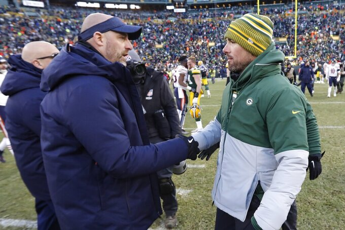 Chicago Bears head coach Matt Nagy shakes hands with Green Bay Packers head coach Matt LaFleur after an NFL football game Sunday, Dec. 15, 2019, in Green Bay, Wis. The Packers won 21-13. (AP Photo/Mike Roemer)