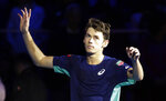 Australia's Alex De Minaur celebrates after winning the ATP Next Gen tennis tournament semifinal match against United States' Frances Tiafoe, in Milan, Italy, Friday, Nov. 8, 2019. (AP Photo/Luca Bruno)