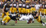 Penn State quarterback Ta'Quan Roberson (2) dives for more yards as Iowa linebackers Jack Campbell (31) and Seth Benson (44) make the tackle during the second half of an NCAA college football game, Saturday, Oct. 9, 2021, in Iowa City, Iowa. Iowa won 23-20. (AP Photo/Matthew Putney)