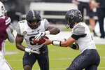 Vanderbilt running back Rocko Griffin (9) takes a handoff from Vanderbilt quarterback Ken Seals (8) during the first half of an NCAA college football game against Mississippi State in Starkville, Miss., Saturday, Nov. 7, 2020. (AP Photo/Rogelio V. Solis)